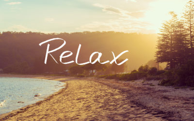Handwritten text over sunset calm sunny beach background RELAX vintage filter applied motivational concept image