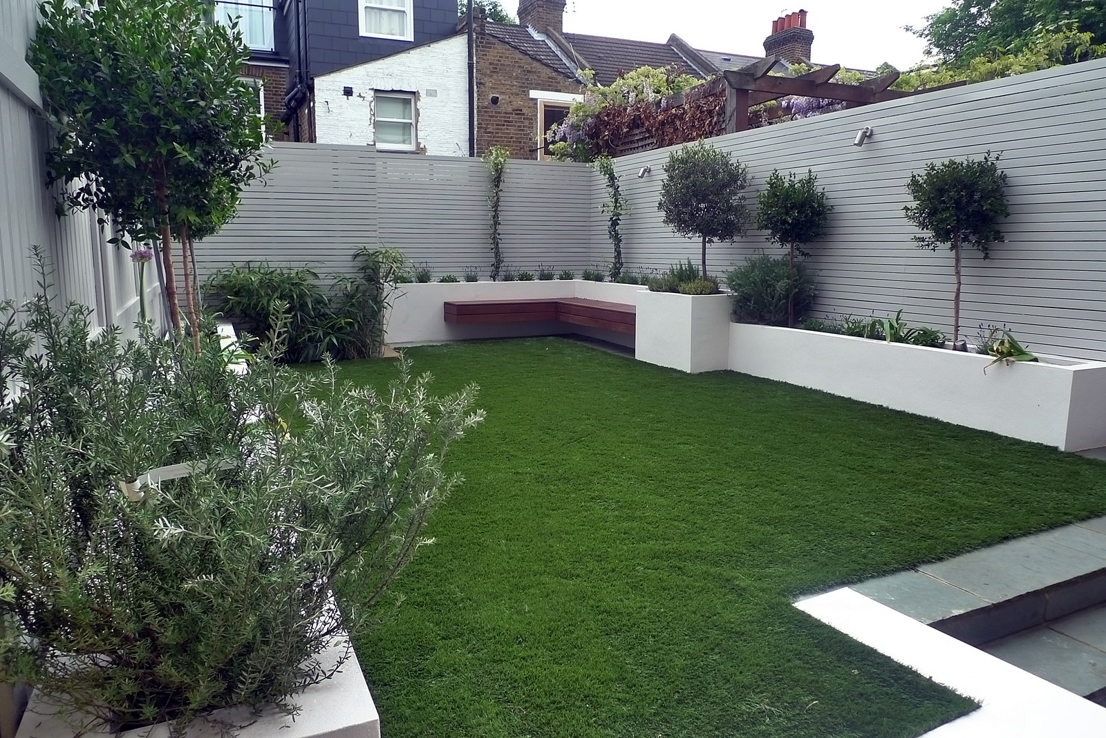 Artificial grass easi grass grey painted fences modern ... on Modern Backyard Patio Ideas  id=85797