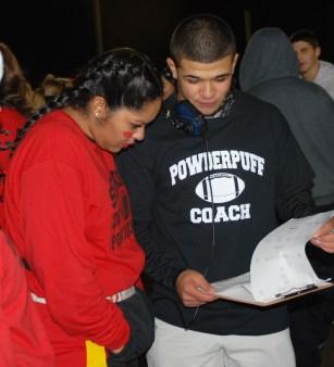 Alex Mejia and Angelica Calderon go over the seniors' game plan.