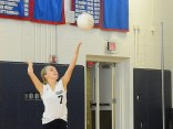 Katie Gardner serving the ball.