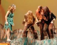 """Mowgli """"monkeys around"""" with the monkeys played by Catherine Crocker, Rebecca Portela and Brittiana Garcia."""