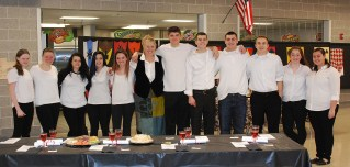The servers of the medieval feast were led by Mrs. Patton.