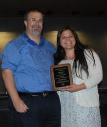 Track Coach Randy Grimmett presents an award to Georgia Panagiotidis