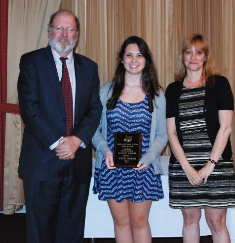 Superintendent John Retchless and Guidance Director Melanie Shaw presented junior Alyssa Collins with the Overall Outstanding Academic Achiever Award for Grade 11.