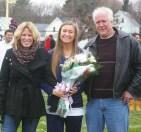 Senior Captain Kelsey Girard with her parents, Kerry and John