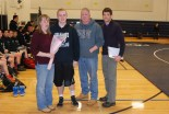 Senior Owen Martin with his Mother and Father and Coach Brown
