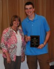 Josepah Campanile is presented with the Grade 9 Academic Achiever Award in Health.