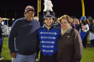 Mark Ewell with his parents Kathryn and Peter