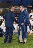 Greg Makarski receives his diploma