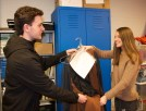Kelsey Willett was costume organizer. Here she gives Joe Naughton his murderer's costume for Macbeth.
