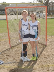 Kaylee Patten (left) and Emily Beatrice are co-captains of the lacrosse team. courtesy photo/yearbook