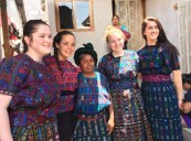Saoirse McNally, Grace Oliver, Hope Geary and Dana Peck model their dresses, traditional Mayan traje, made by the women artisans of Guatemala. photo courtesy of Amanda Lanigan