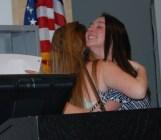 Noelle Atkins and Hannah Murphy share a hug.