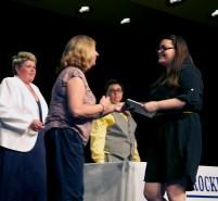 Brenda Folsom presents the Health Department academic award at the senior awards night to Rachel Buker. Veritas photo
