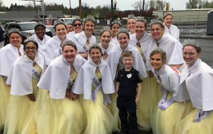 Sumner Police's Chief for a Day, Reid, gets a moment with all the Daffodil Princesses.