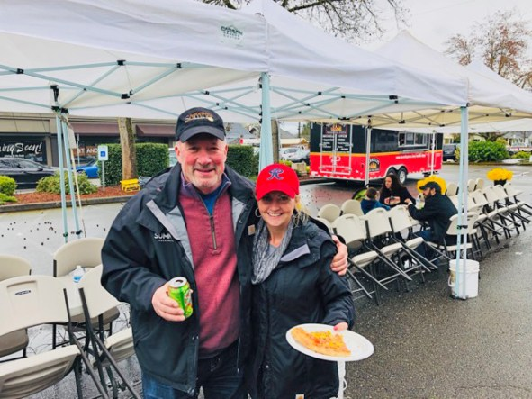 Mayor Bill Pugh joins the City's Lana Hoover in welcoming Food Trucks to the Pre-Parade Party.