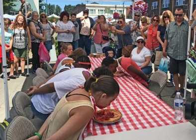 The kids tried the Rhubarb Pie-Eating contest first. Pies & prizes sponsored by Sumner's Fred Meyer.