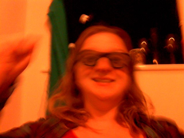 A blurred photo of me flailing in my 3D glasses