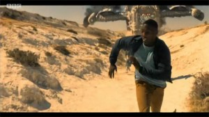 Ryan runs away from a crashing spaceship.