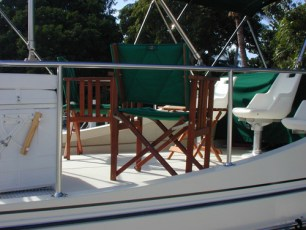 Folding wooden chairs as additional flybridge seating