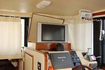 Custom flat screen TV storage compartment