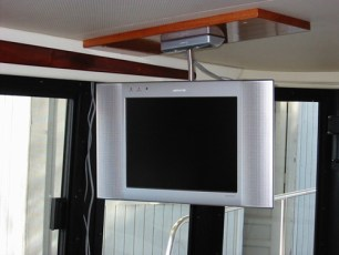 Folding flat screen tv mounted to ceiling - being installed