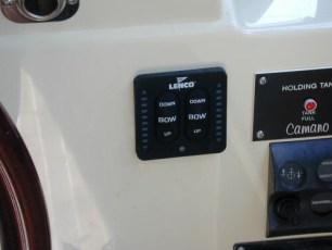 Trim tab controls at lower helm