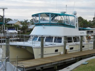 A custom flybridge cover and bimini