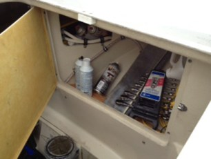 Tool cabinet above engine strainers