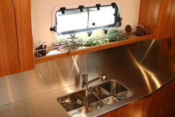 Stainless steel countertops in the galley