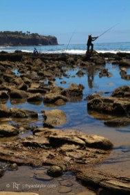 Fisherman casting off Palos Verdes, CA