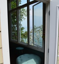 A view of the lake through the windows of the bunkie