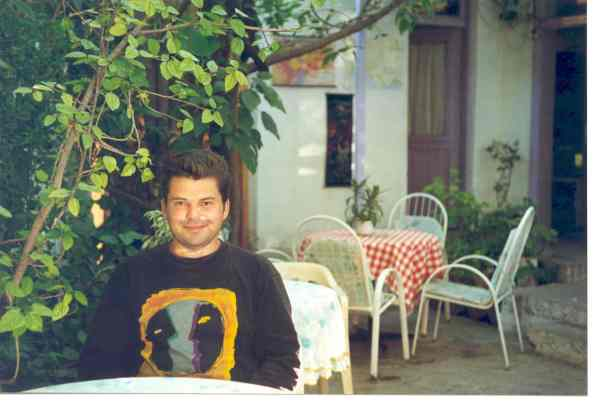 In Turkey, 1994. It was very hot and I was ill but I seem cheerful enough and the food was great!