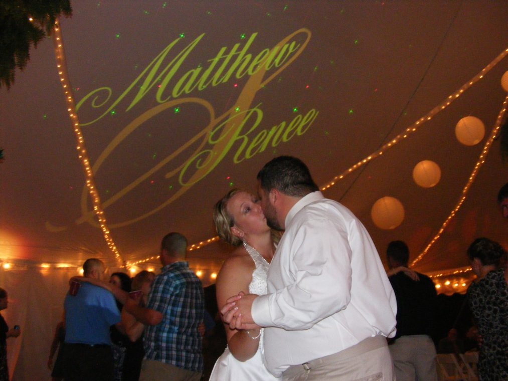Matthew and Renee under their custom monogram