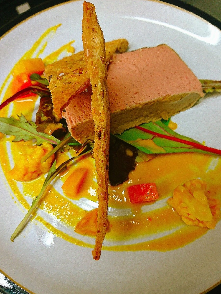 Chicken liver parfait on bed of house leaves, homemade piccalilli, wholemeal wafers