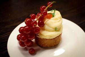 Carrot cake, cream cheese frosting, draped berries