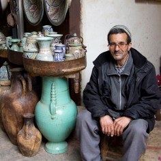 Kind man with beautiful vases