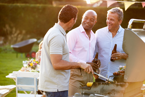 men at a barbeque with one beer
