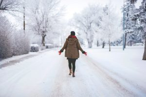 dry january benefits woman walking in the snow