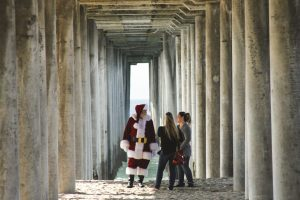 navigating the holidays sober talking with santa under a bridge