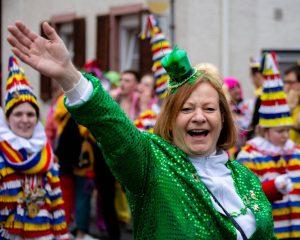 woman in green at parade st patricks day sober