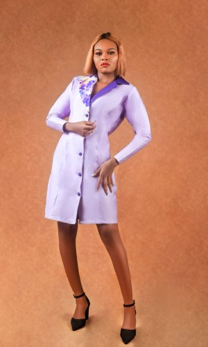 lady wearing a lavender hourglass blazer dress designed by Ria Kosher