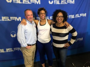 Kim Moore, owner of The Fitness Snob, along with RIA Radio hosts Kyle Todd and Michelle Yancey.
