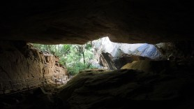 An adventurous climb up the mountain through a narrow cleavage beneath two parts of rock.