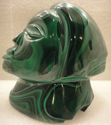 malachite carved face of woman - special exhibit at Rice Northwest Rock and Mineral Museum