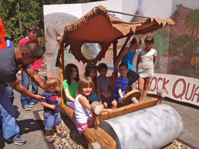 Posing in the Flintstone Mobile at the Rice Museum of Rocks and Minerals (5)