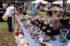 Geodes and other minerals and rocks for sale at vendor booth.