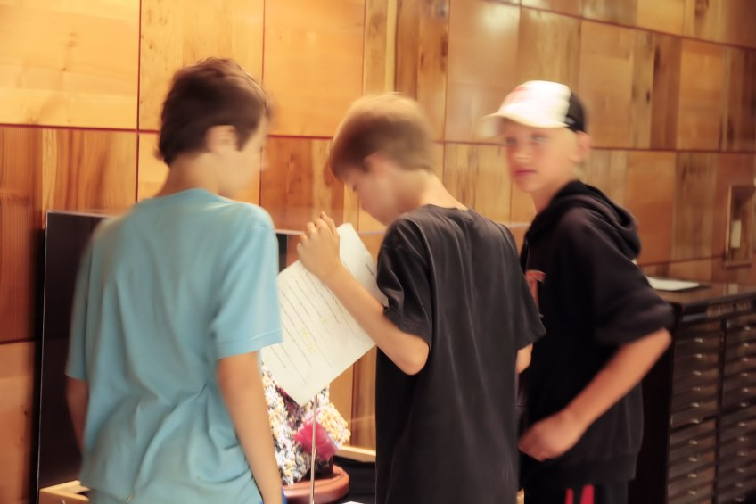 Three boys examine the Rhodochrosite in the Rice Northwest Museum.