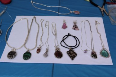 Display of jewelry making demonstration on making necklaces with silver wire.