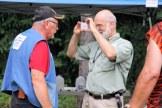 Julian Gray photographs club member at Summer Fest.